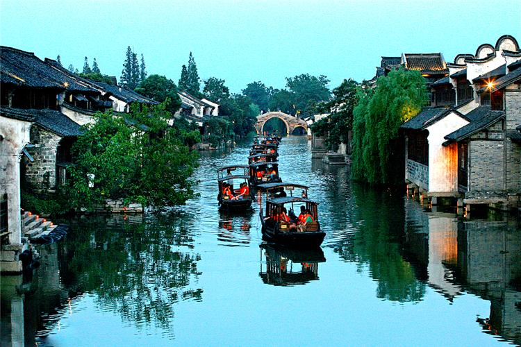 火车+上海杭州宋城+乌镇西栅+苏州拙政园+无锡+南京7日游